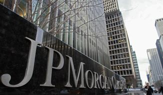 **FILE** A JP Morgan Chase building sign is seen in New York on Feb. 4, 2011. (Associated Press)