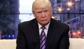 "** FILE ** In this Sept. 16, 2013, photo, Donald Trump appears on the ""Fox & Friends"" television program in New York. He is toying with the idea of challenging New York Gov. Andrew Cuomo. (AP Photo/Richard Drew)"