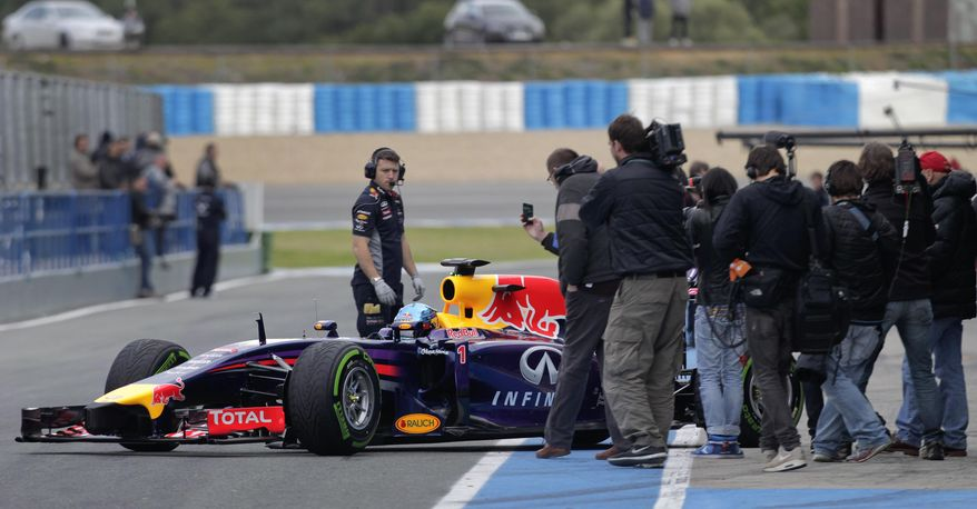 Infiniti Red Bull Racing driver Sebastian Vettel of Germany exits his garage to drive the new RB10 Formula One car at the Circuito de Jerez on Tuesday, Jan. 28, 2014, in Jerez de la Frontera, Spain. (AP Photo/Miguel Angel Morenatti)