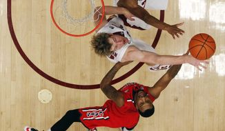 Arizona forward Rondae Hollis-Jefferson, bottom, shoots over Stanford center Grant Verhoeven during the first half of an NCAA college basketball game on Wednesday, Jan. 29, 2014, in Stanford, Calif. (AP Photo/Marcio Jose Sanchez)
