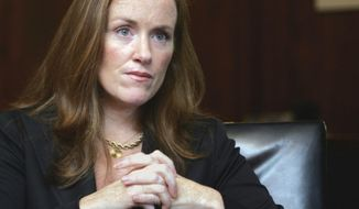 FFILE- In this Sept. 14, 2006 file photo, Nassau County District Attorney Kathleen Rice listens to a reporter's questions in her Mineola, N.Y. office.  The  suburban New York prosecutor who has attracted national headlines for murder convictions in drunken driving cases and a crackdown on college entrance exam cheating announced on Wednesday, Jan. 29, 2014, that she is running for congress. Rice, who won a double-digit victory in November 1013 as Nassau County district attorney, said that she will be the Democratic candidate to succeed retiring Rep. Carolyn McCarthy. (AP Photo/Ed Betz, File)