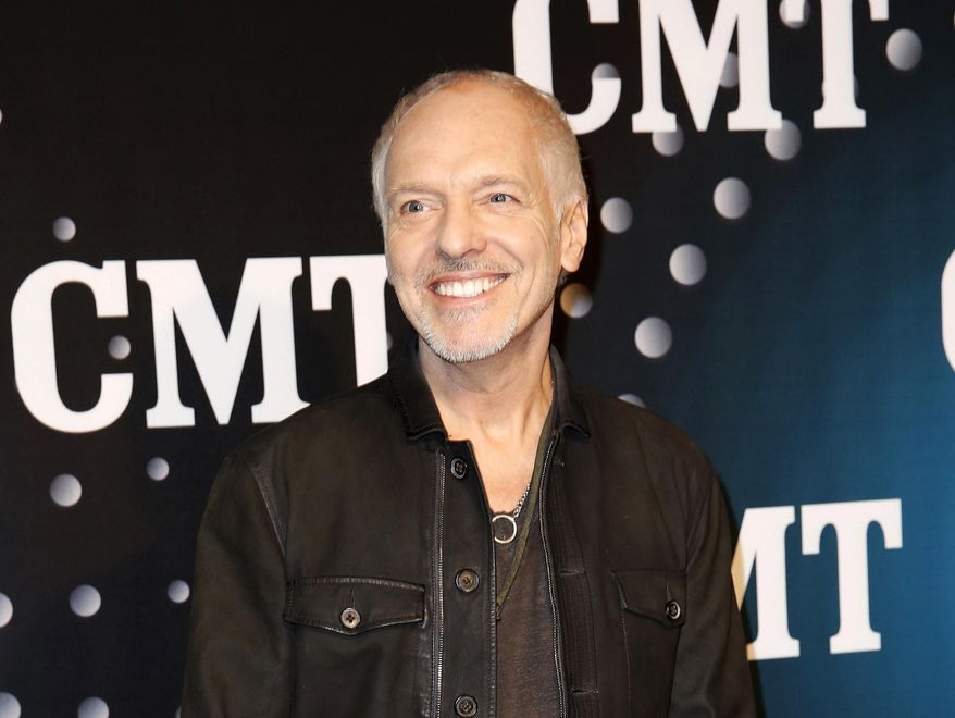 """FILE - This Dec. 3, 2013 file photo shows Peter Frampton posing on the red carpet at the CMT """"Artists of the Year at Bridgestone Arena in Nashville, Tenn. The Musicians Hall of Fame inducted 12 new members, Tuesday, Jan. 28, 2014, across the genres, including bluesman Buddy Guy, British rock guitarist Peter Frampton and pedal steel player and country singer Barbara Mandrell. (Photo by Donn Jones/Invision/AP, File)"""