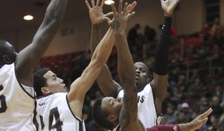 Massachusetts guard Derrick Gordon (2) looks to score past St. Bonaventure guard Matthew Wright (24) and other defenders during the first half of an NCAA college basketball game in St. Bonaventure, N.Y., Wednesday, Jan. 29, 2014. (AP Photo/Nick LoVerde)