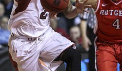 Temple's Will Cummings drives past Rutgers' Myles Mack during the first half of an NCAA basketball game, Wednesday, Jan. 29, 2014 in Philadelphia. (AP Photo/Philadelphia Daily News, Steven M. Falk)  THE EVENING BULLETIN OUT, TV OUT; MAGS OUT; NO SALES
