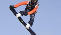FILE - In this Jan. 18, 2013, file photo, Torah Bright, of Australia, flies over a jump during the women's slopestyle finals at the Snowboard World Championship in Stoneham, Quebec. The Australian star will compete in the halfpipe, slopestyle and snowboardcross competitions at next month's Olympics.  (AP Photo/The Canadian Press, Jacques Boissinot, File)