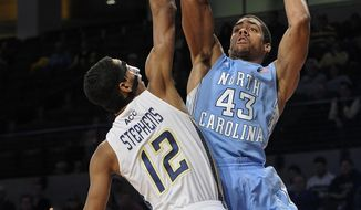 North Carolina forward James Michael McAdoo (43) shoots as Georgia Tech forward forward Quinton Stephens defends during the second half of an NCAA college basketball game, Wednesday, Jan. 29, 2014, in Atlanta. North Carolina won 78-65. (AP Photo/John Amis)