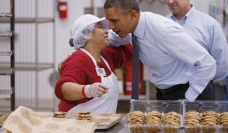 President Barack Obama greets an employee in the bakery at a Costco store in Lanham, Md. Wednesday, Jan. 29, 2014, where he spoke about raising the minimum wage the morning after his State of the Union address.  (AP Photo/Charles Dharapak)