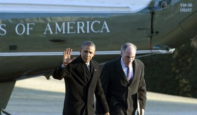 President Barack Obama waves to the media as he returns to the White House after an event in Pittsburgh, Pa., accompanied by Sen. Robert Casey, D-Pa., as they walk toward the Oval Office of the White House in Washington, Wednesday Jan. 29, 2014. (AP Photo/Jacquelyn Martin)