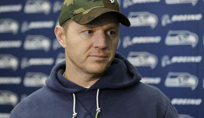 Seattle Seahawks offensive coordinator Darrell Bevell listens to a question as he talks to reporters Wednesday, Jan. 15, 2014, after NFL football practice in Renton, Wash. The Seahawks will play the San Francisco 49ers Sunday in the NFC championship. (AP Photo/Ted S. Warren)