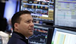 Specialist Paul Cosentino works at his post on the floor of the New York Stock Exchange Wednesday, Jan. 29, 2014. The U.S. stock market stumbled briefly after the Federal Reserve decided to further reduce its economic stimulus. (AP Photo/Richard Drew)