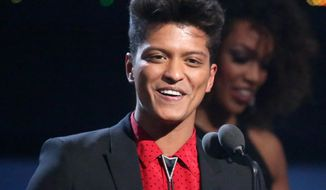 """FILE - This Jan. 26, 2014 file photo shows Bruno Mars accepting the award for best pop vocal album for """"Unorthodox Jukebox"""" at the 56th annual Grammy Awards in Los Angeles. Mars will answer questions about his Super Bowl halftime performance at the Rose Theater in the Time Warner Center in New York City on Thursday. Renee Fleming, who will sing the national anthem, will give a press conference before Mars. (Photo by Matt Sayles/Invision/AP, File)"""