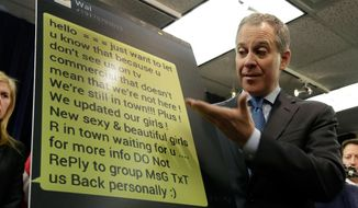 "New York Attorney General Eric Schneiderman shows an enlarged text message as he addresses a news conference, in New York, Thursday, Jan. 30, 2014.  Police were rounding up 18 people in New York City on Thursday on allegations they sold ""party packs"" of cocaine and sex to high-end clients and texted their customers to advertise ahead of this week's Super Bowl festivities. (AP Photo)"