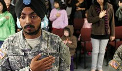 Cpl. Simran Preet Singh Lamba is the first enlisted soldier to be granted a religious accommodation for his Sikh articles of faith since 1984. (Associated Press)