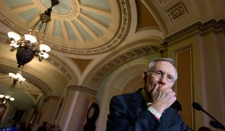 "Senate Majority Leader Harry Reid rejected giving President Obama ""fast-track"" authority that would limit lawmakers to an up-or-down vote on trade deals, without amendments. ""I think everyone would be well-advised just not to push this right now,"" said the Nevada Democrat. (ASSOCIATED PRESS PHOTOGRAPHS)"