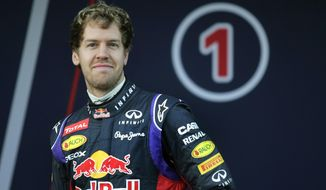 Infiniti Red Bull Racing driver Sebastian Vettel of Germany attends the launch of his new RB10 Formula One car at the Circuito de Jerez on Tuesday, Jan. 28, 2014, in Jerez de la Frontera, Spain. (AP Photo/Miguel Angel Morenatti)