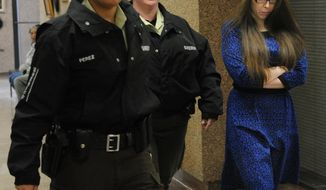 In this photo from Jan. 27, 2014, escorted by sheriff's deputies, Tiffany Klapheke, right, leaves the jury selection room at the Taylor County Courthouse in Abilene, Texas. Klapheke is with injury to a child in the August 2012 death of her 22-month-old daughter, Tamryn Klapheke, who died of malnutrition and dehydration. (AP Photo/Abilene Reporter-News, Nellie Doneva)
