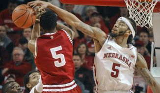 Nebraska guard/forward Terran Petteway (5) gets a block against Indiana forward Troy Williams (5) during an NCAA college basketball game, Thursday, Jan. 30, 2014 in Lincoln, Neb.(AP Photo/Dave Weaver)