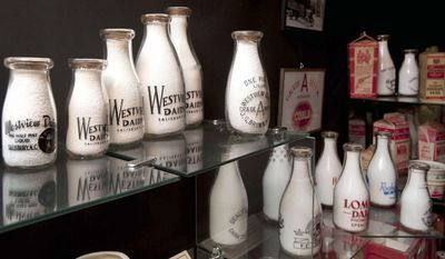 FOR RELEASE SATURDAY, FEBRUARY 1, 2014, AT 12:01 A.M. EST - In this photo from Jan. 16, 2014, a display of milk bottles are on display in Spencer, N.C., Spencer resident John Patterson has brought his large milk bottle collection to the foyer at the Bumper to Bumper automobile exhibit at the North Carolina Transportation Museum. The collection coincides with the newest donation to the museum, a restored 1959 DIVCO milk truck. (AP Photo/The Salisbury Post, Jon C. Lakey)