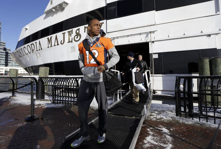 Denver Broncos wide receiver Andre Caldwell (12) leaves the luxury yacht where the team's daily news conferences are held Wednesday, Jan. 29, 2014, in Jersey City, N.J. The Broncos are scheduled to play the Seattle Seahawks in the NFL Super Bowl XLVIII football game Sunday, Feb. 2, in East Rutherford, N.J. (AP Photo/Mark Humphrey)