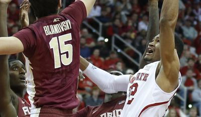 Florida State's Boris Bojanovsky (15) blocks the shot of N.C. State's Kyle Washington (32) during the first half of an NCAA basketball game, Wednesday, Jan. 29, 2014 in Raleigh, N.C. (AP Photo/The News & Observer, Ethan Hyman) MANDATORY CREDIT: ETHAN HYMAN, THE NEWS & OBSERVER