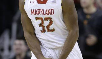 Maryland guard Dez Wells reacts after Miami called a timeout in the second half of an NCAA college basketball game in College Park, Md., Wednesday, Jan. 29, 2014. Wells contributed a team-high 21 points in Maryland's 74-71 win. (AP Photo/Patrick Semansky)