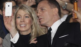 "FILE - This is a Nov. 16, 2012 file photo of actor Daniel Craig as he takes a photo with a fan in the crowd during the premier of the latest James Bond film, ""Skyfall""  in Sydney, Australia.  A former tabloid reporter who admits illegally snooping on voicemails says he ""routinely"" hacked the phone of actor Daniel Craig. Dan Evans has pleaded guilty to phone hacking while at the News of the World and the Sunday Mirror. He is a prosecution witness at the trial in London of former News of the World editors Andy Coulson and Rebekah Brooks, and five others. He told the jury on Thursday Jan. 30, 2014  ""I was routinely hacking Daniel Craig's phone from my Sunday Mirror days."" He said he obtained a story about supermodel Kate Moss from Craig's voicemail messages. (AP Photo/Rob Griffith, File)"