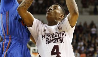 Mississippi State guard Trivante Bloodman (4) tries a layup past Florida guard Kasey Hill, left, in the first half of an NCAA college basketball game in Starkville, Miss., Thursday, Jan. 30, 2014. No. 3 Florida won 62-51. (AP Photo)