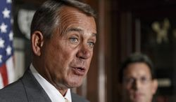 ** FILE ** This Jan. 28, 2014, file photo shows House John Boehner of Ohio, accompanied by House Majority Leader Eric Cantor of Va. speaking at Republican National Committee headquarters in Washington. (AP Photo/J. Scott Applewhite, File)