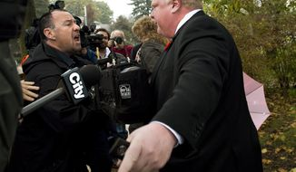 File-This Oct. 31, 2013, file photo shows Toronto Mayor Rob Ford telling the media to get off his property as he leaves his home in Toronto. Pop star Justin Bieber is giving Ford a brief respite as Canada's favorite bad boy and butt of all jokes. But the comparison may not be a fair one. The 19-year-old teen idol is facing the equivalent of a misdemeanor assault charge. Ford has admitted smoking crack while in a drunken stupor and is being sued for supposedly orchestrating the jailhouse beating of his sister's ex-boyfriend. (AP Photo/, Nathan Denette, File)