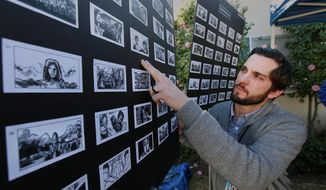 In this photo taken Jan. 13, 2014, Nathan Crow, Creative Director at RPA: Rubin Postaer and Associates, an advertisement agency, checks a story board in Pasadena, Calif., before a film crew films a commercial for Goldie Blox, a small business who was awarded the Intuit Small Business Big Game to be highlighted during the 2014 Super Bowl. Intuit, with the help of the public, selected Goldie Blox: Engineering Toys for Girls. (AP Photo/Nick Ut)