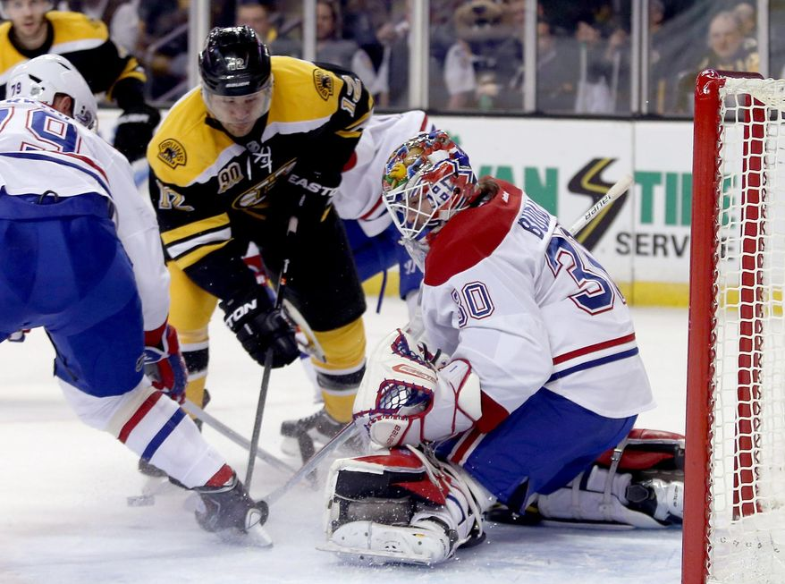 Montreal Canadiens goalie Peter Budaj (30), of Slovakia, makes a save as Boston Bruins right wing Jarome Iginla (12) looks for a rebound during the second period of an NHL hockey game on Thursday, Jan. 30, 2014, in Boston. (AP Photo/Mary Schwalm)