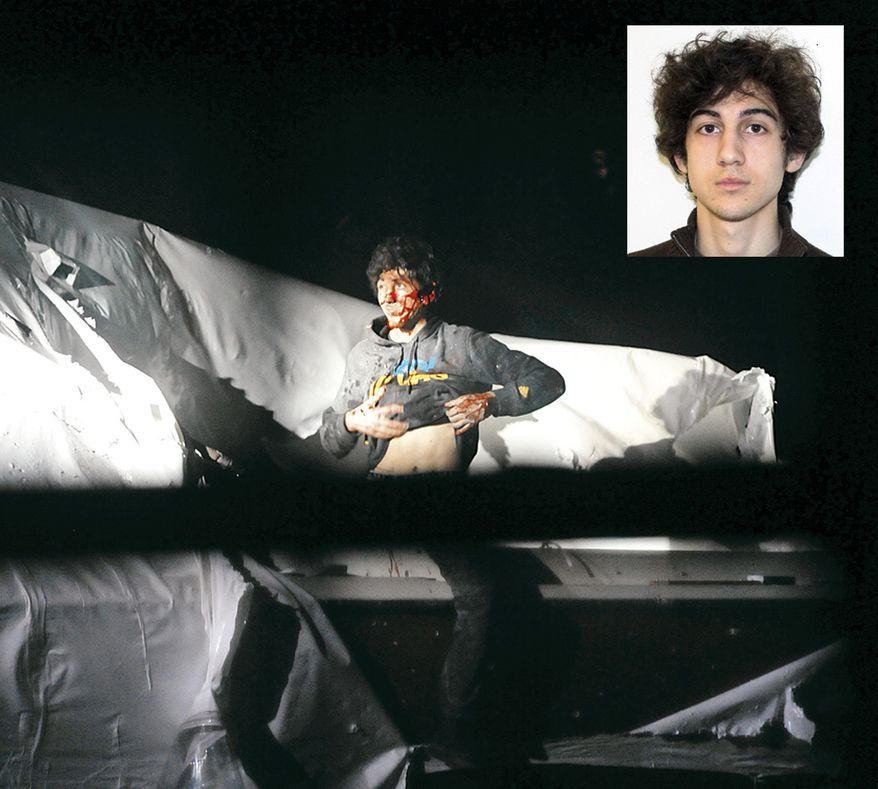 ** FILE ** In this Friday, April 19, 2013, photo provided by the Massachusetts State Police, Boston Marathon bombing suspect Dzhokhar Tsarnaev lifts his shirt while standing in a boat at the time of his capture by law enforcement authorities in Watertown, Mass. (AP Photo/Massachusetts State Police, Sean Murphy)