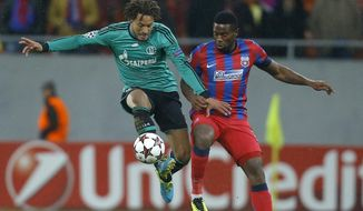 FILE - In this Nov. 26, 2013, file photo, Schalke's Jermaine Jones, left, controls the ball ahead of Bucharest's Fernando Varela during their Champions League soccer match at the National Arena in Bucharest, Romania. Jones, an American midfielder, has been loaned to the Turkish club Besiktas from Schalke for the rest of the season after telling the Bundesliga team he wanted a move before the winter transfer window closes Friday, Jan. 31, 2014. (AP Photo/Vadim Ghirda, File)