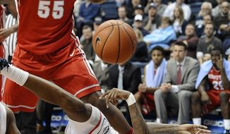Connecticut's Phillip Nolan, bottom, passes the ball as Houston's J.J. Richardson, left, defends during the first half of an NCAA college basketball game, Thursday, Jan. 30, 2014, in Storrs, Conn. (AP Photo/Jessica Hill)