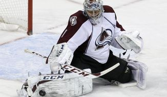 Colorado Avalanche goalie Semyon Varlamov (1), of Russia, stops a shot from the Dallas Stars in the third period of an NHL hockey game, Monday, Jan. 27, 2014, in Dallas. Varlamov made 41 saves in the 4-3 Avalanche win. (AP Photo/Tony Gutierrez)