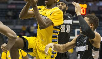 Marquette's Jajuan Johnson, left, drives past Providence's Josh Fortune, right, and LaDontae Henton during the first half of an NCAA college basketball game on Thursday, Jan. 30, 2014, in Milwaukee. (AP Photo/Tom Lynn)