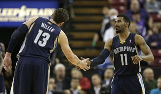 Memphis Grizzlies forward Mike Miller, left, congratulates teammate Mike Conley after Conley scored against the Sacramento Kings during the fourth quarter of an NBA basketball game in Sacramento, Calif., Wednesday, Jan. 29, 2014.  The Grizzlies won 99-89.(AP Photo/Rich Pedroncelli)
