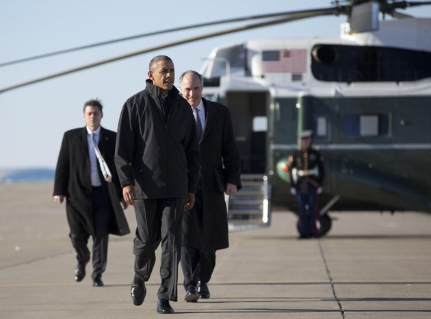President Barack Obama, followed by Sen Bob Casey, D-Pa., walks from Marine One to board Air Force One at the171st Air Refueling Wing Pennsylvania Air National Guard, Wednesday, Jan. 29, 2014, in Coraopolis, Pa., en route to Washington after speaking at the U.S. Steel Irvin Plant, in West Mifflin, Pa., about retirement policies he highlighted in the State of the Union address. (AP Photo/Carolyn Kaster)