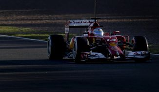 Fernando Alonso of Spain and Ferrari drives the new F14T car during the 2014 Formula One Testing at the Circuito de Jerez on Thursday, Jan. 30, 2014, in Jerez de la Frontera, Spain. (AP Photo/Miguel Angel Morenatti)