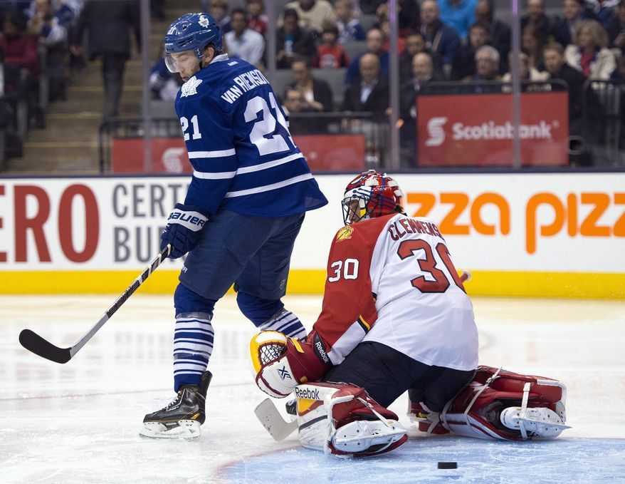 Toronto Maple Leafs left winger James van Riemsdyk (21) scores on Florida Panthers goaltender Scott Clemmensen during the second period of an NHL hockey game in Toronto on Thursday, Jan. 30, 2014. (AP Photo/The Canadian Press, Frank Gunn)