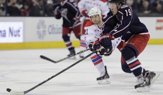 Columbus Blue Jackets' Ryan Johansen, right, carries the puck across the blue line as Washington Capitals' Brooks Laich defends during the second period of an NHL hockey game, Thursday, Jan. 30, 2014, in Columbus, Ohio. The Blue Jackets beat the Capitals 5-2. (AP Photo/Jay LaPrete)
