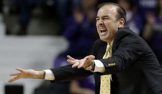 George Washington coach Mike Longeran questions a call during the first half of an NCAA college basketball game against the Kansas State Tuesday, Dec. 31, 2013, in Manhattan, Kan. (AP Photo/Charlie Riedel)
