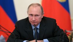 Russian President Vladimir Putin chairs a meeting with officials focusing on economy in the Novo-Ogaryovo residence outside Moscow, Russia, Thursday, Jan. 30, 2014.  (AP Photo/RIA-Novosti, Mikhail Metzel, Presidential Press Service)