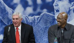 Karl Malone, right, laughs as former Utah Jazz coach Jerry Sloan speaks during a news conference to honor Sloan on Friday, Jan. 31, 2014, in Salt Lake City.  (AP Photo/The Salt Lake Tribune, Scott Sommerdorf) LOCAL TV OUT; MAGAZINES OUT; DESERET NEWS OUT