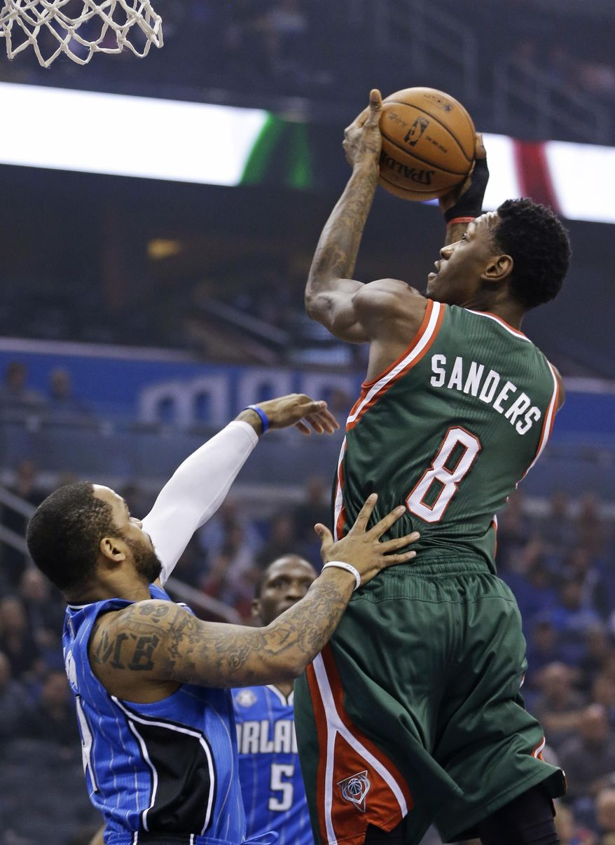 Milwaukee Bucks' Larry Sanders (8) makes a shot over Orlando Magic's Jameer Nelson, left, during the first half of an NBA basketball game in Orlando, Fla., Friday, Jan. 31, 2014. (AP Photo/John Raoux)
