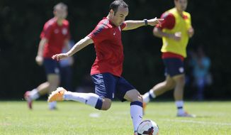 FILE - In this Jan. 22, 2014, file photo, United States' Landon Donovan kicks the ball during a soccer training session in Sao Paulo. Donovan and the U.S. soccer team are back home after a 12-day camp in Brazil, and they're ready to start figuring out how the pieces will fit at the World Cup. Even with several key players, in Europe, coach Jurgen Klinsmann hopes to learn a little more in Saturday's exhibition against South Korea. (AP Photo/Nelson Antoine, File)