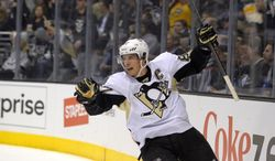 Pittsburgh Penguins center Sidney Crosby celebrates a goal by left wing Jussi Jokinen, of Finland, during the first period of an NHL hockey game against the Los Angeles Kings, Thursday, Jan. 30, 2014, in Los Angeles. (AP Photo)