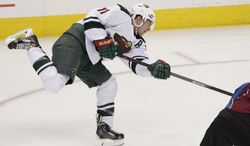 Minnesota Wild's Zach Parise (11) scores his second goal of the game past Colorado Avalanche goalie Semyon Varlamov, of Russia, during the third period of an NHL hockey game on Thursday, Jan. 30, 2014 in Denver. The Avalanche won 5-4. (AP Photo/Barry Gutierrez)