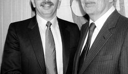 FILE - In this Nov. 16, 1983, file photo, incoming NBA Commissioner David J. Stern, left, shakes hands with outgoing commissioner Larry O'Brien, right, in New York. He is not in the Hall of Fame, he never played in an All-Star game and he is about a foot shorter than most NBA stars. But try to find an NBA legacy more lasting than Stern's, who is retiring Saturday, Feb. 1, 2014 after exactly 30 years on the job. (AP Photo/David Pickoff, File)