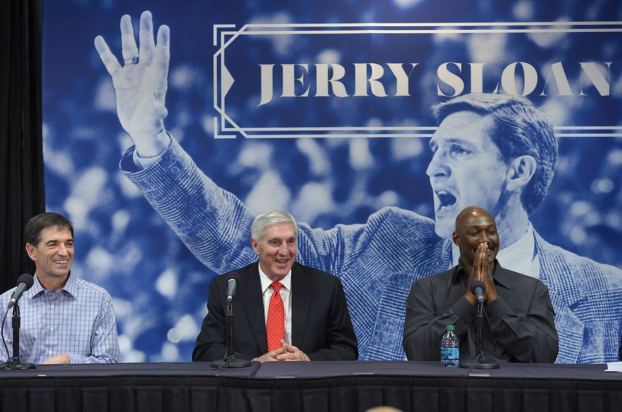 John Stockton, left, and Karl Malone, right, laugh during a news conference to honor former Utah Jazz coach Jerry Sloan, center,  on Friday, Jan. 31, 2014, in Salt Lake City.  (AP Photo/The Salt Lake Tribune, Scott Sommerdorf) LOCAL TV OUT; MAGAZINES OUT; DESERET NEWS OUT